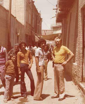 A European tourist with two students of the Peshawar University in an old street of Peshawar (1974)