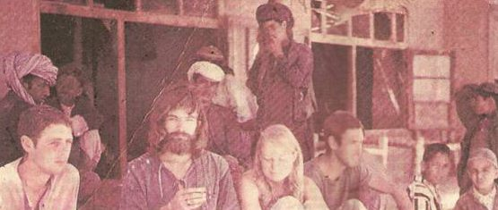 Young American and European tourists with the locals at a restaurant in Ziarat, Balochistan in 1973