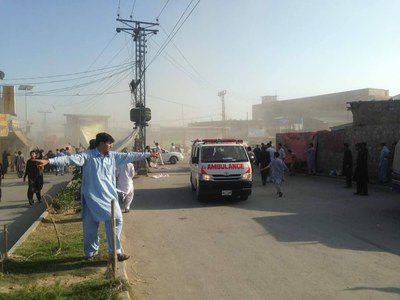 Ambulances transport injured individuals from the blast site.